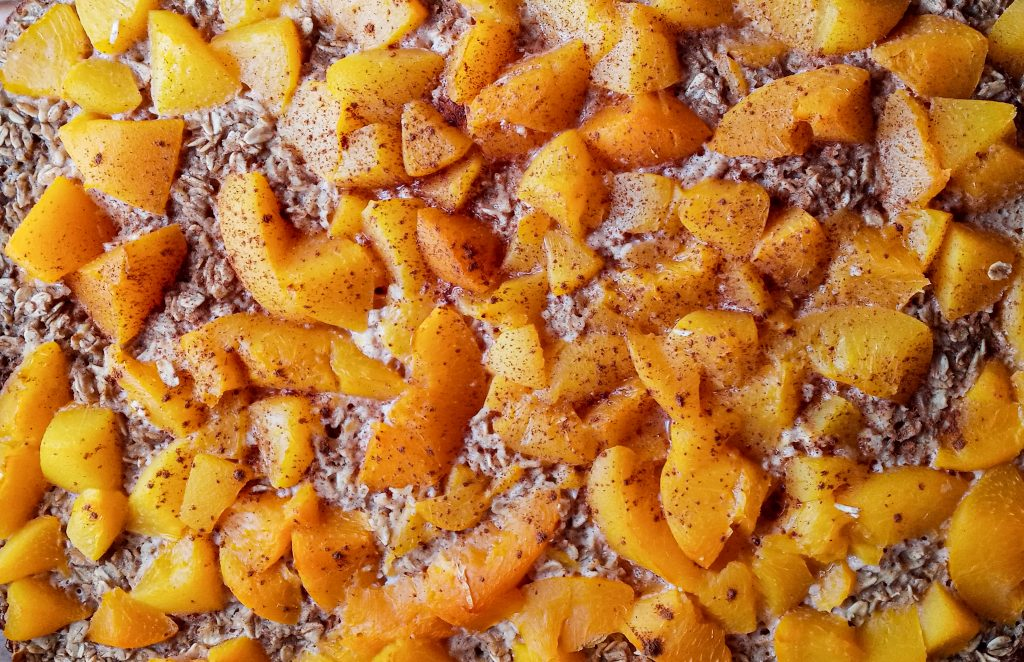 close up of peach baked oatmeal