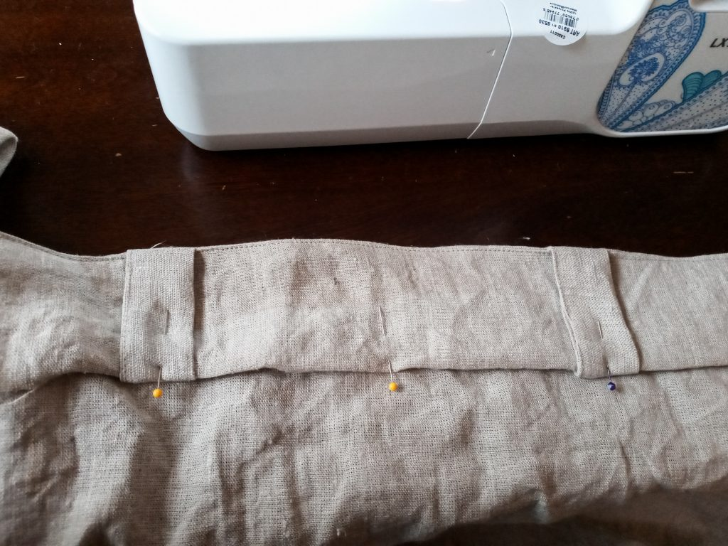 Pinning the tabs for sewing curtains